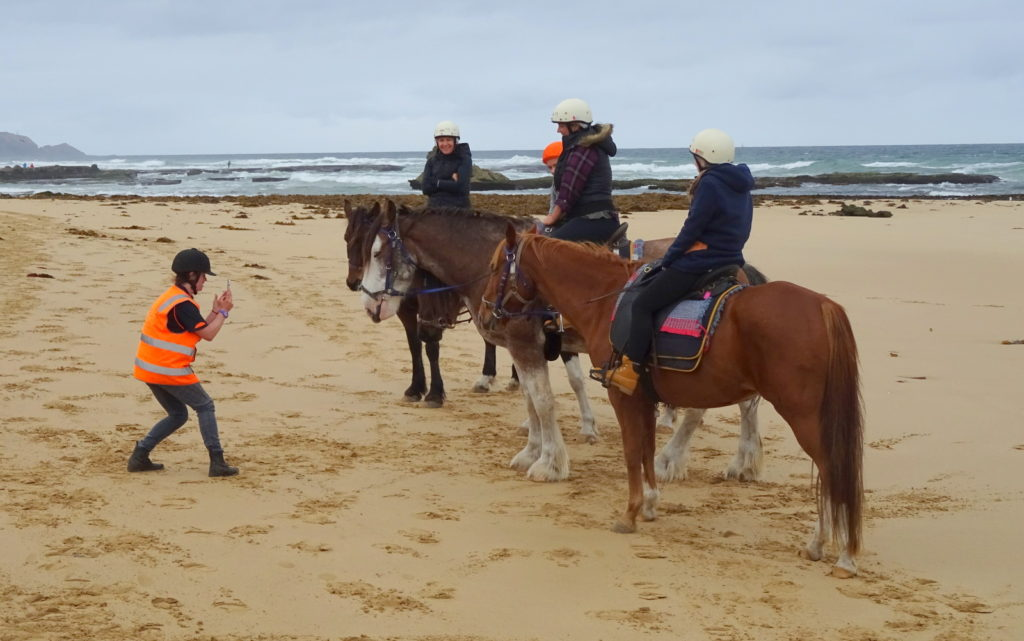 Birthday girls pose with horses on St. Andrews Beach