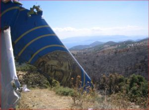 Tail assembly of Helios Flight 527 rests on a hillside. Photo of the Air Accident Investigation and Aviation Safety Board