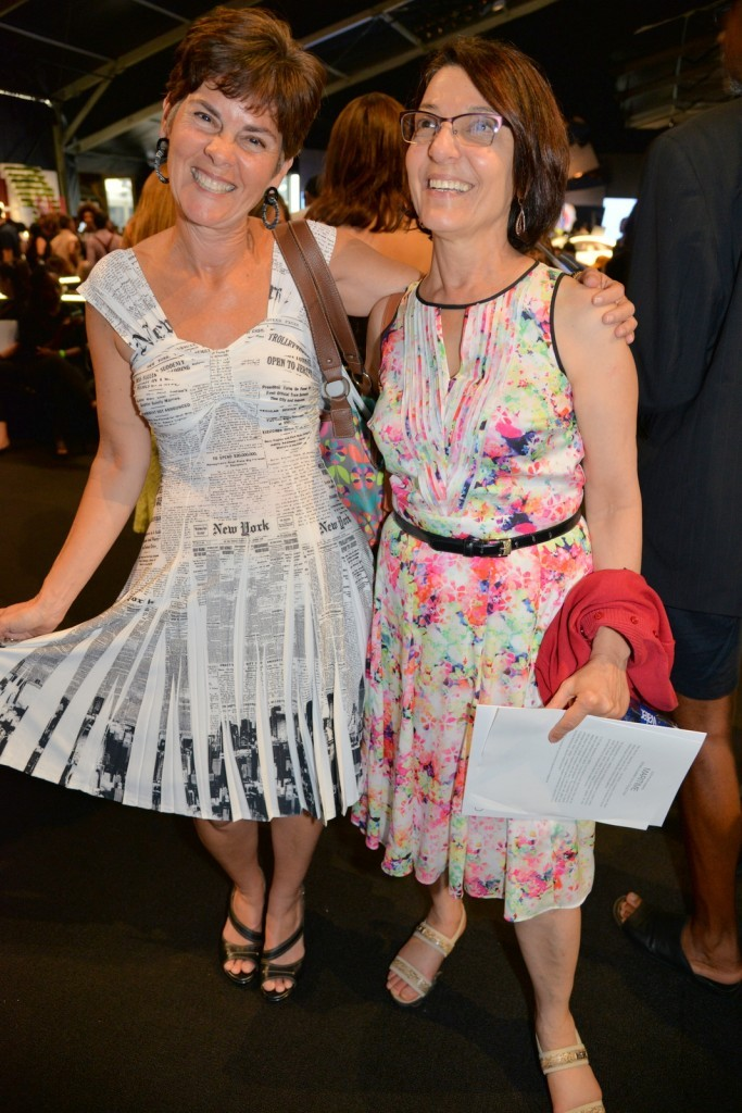 What I wore to Fashion Week, my New York Times-themed dress. With my friend, Sabah Hassounah. Photo courtesy Cheryl Bemis / Fashionably Austin
