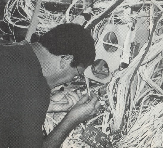 Bob Swaim examining wiring from TWA Flight 800 (1997)