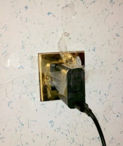 Plug must be taped to the wall